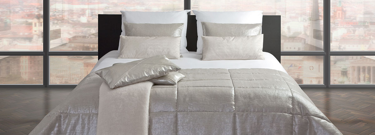 Cushion Silver on bed