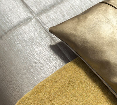 Leather Cushions Pavilion in Brass and Piccalilli Throw on silver coated bedspread